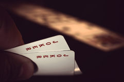 Hand with playing cards Stock Image