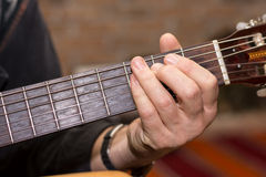 Hand playing chords on the guitar Royalty Free Stock Photos