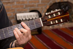 Hand playing chords on the guitar Stock Photos