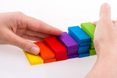 Hand playing with colored domino Royalty Free Stock Images