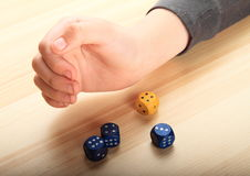 Hand playing with dice Royalty Free Stock Image