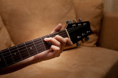 hand playing folk guitar Royalty Free Stock Photography