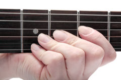 Hand playing on guitar Stock Photo