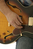 Hand playing guitar. Close up of electric guitar being played Royalty Free Stock Images