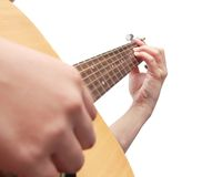 Hand playing guitar Royalty Free Stock Images