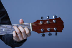 Hand Playing On Neck Of Guitar Royalty Free Stock Photos