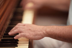 Hand playing the piano. Mans hand playing the piano Royalty Free Stock Photography