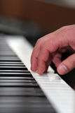Hand playing piano. Playing piano classic music. Sound note. Shallow depth of field stock photography