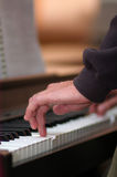 Hand playing piano. Playing piano classic music. Sound note. Shallow depth of field royalty free stock photos