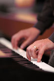 Hand playing piano. Playing piano classic music. Sound note. Shallow depth of field, diagonal view stock photo