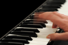 Hand Playing the Piano. A hand in motion playing the piano Royalty Free Stock Photos