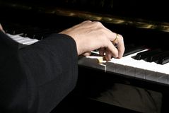 Hand playing piano Royalty Free Stock Image