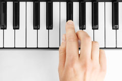 Hand playing on piano Royalty Free Stock Image