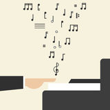 Hand Playing Piano. With Flying Notes Stock Image