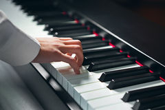 Hand playing the piano Royalty Free Stock Photo