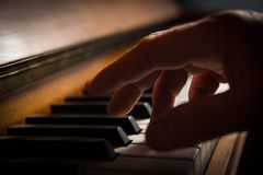 A hand playing piano Royalty Free Stock Image
