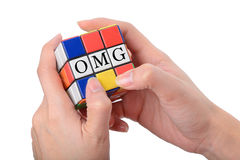 Hand playing Square puzzle to be OMG the well known expression o Stock Photography