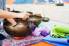 Hand playing yoga bowls outdoors. Royalty Free Stock Photos