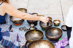 Hand playing yoga bowls outdoors. Royalty Free Stock Photography