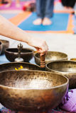 Hand playing yoga bowls outdoors. Royalty Free Stock Photo