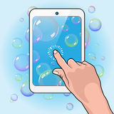 Hand Plays Bubbles Tablet Royalty Free Stock Photos