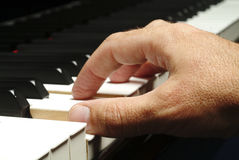 Hand plays piano stock photo