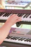 The hand plays a synthesizer. The man hand plays a synthesizer Royalty Free Stock Photos