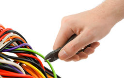 Hand, pliers and cable Royalty Free Stock Images