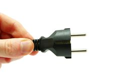Hand with plug Stock Photo