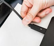 Hand plug laptop power cord cable to charge notebook PC.  stock photo