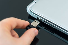 Hand plugging usb flash drive. Royalty Free Stock Images