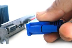 Hand plugging VGA cable connector  to VGA port. Stock Image