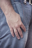Hand in pocket. Male hand in the pocket of jeans Stock Photography