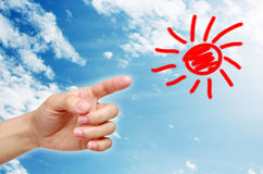 Hand point the cartoon sun in the sky Stock Images