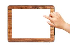 Hand  point on digital tablet pc wood mount Stock Photo