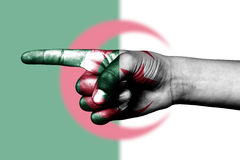 Hand point with finger in algerian national flag Royalty Free Stock Photo