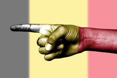 Hand point with finger in Belgium national flag Stock Image