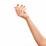 Hand point finger one with red nails on white background Stock Image