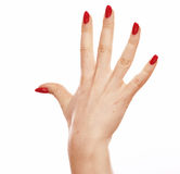 Hand point finger one with red nails on white background Stock Photography