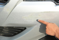 Hand point at scratches on car Stock Photography