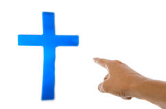 Hand point to the blue cross. Stock Image