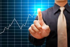 Hand point to high graph Stock Photos