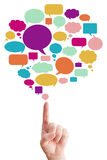 Hand point to many speak bubbles Royalty Free Stock Photography