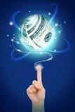 Hand point to money sphere Stock Photos