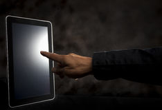 Hand point to touching on tablet screen Royalty Free Stock Photo