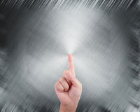 Hand pointing on abstract grey background Royalty Free Stock Image