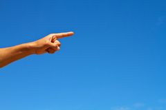 Hand Pointing against blue sky Stock Photography