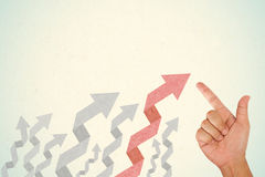 Hand pointing on arrow origami style Stock Photos