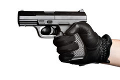 Hand Pointing a Black Handgun Stock Photo