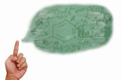 Hand pointing on chemical money structure Royalty Free Stock Images